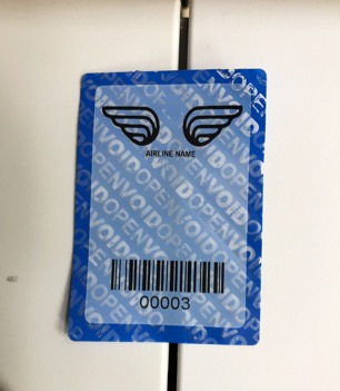 Blue non-residue tamper evident security label designed for aircraft once it has been tampered with and voided