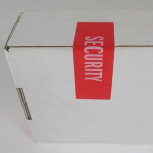 Red Tamper evident security label with white writing on a white box