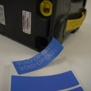 Blue non-residue tamper evident security label for cash boxes