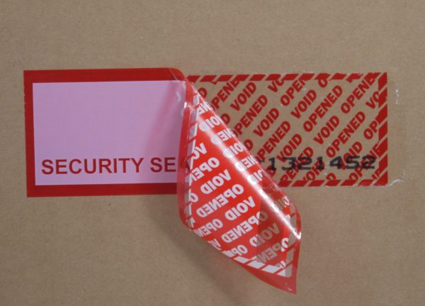 red tamper evident security box tape with subsurface numbering and white panel showing void message