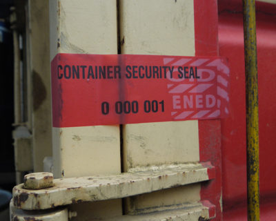 red tamper evident permanent label to secure sea containers during transport
