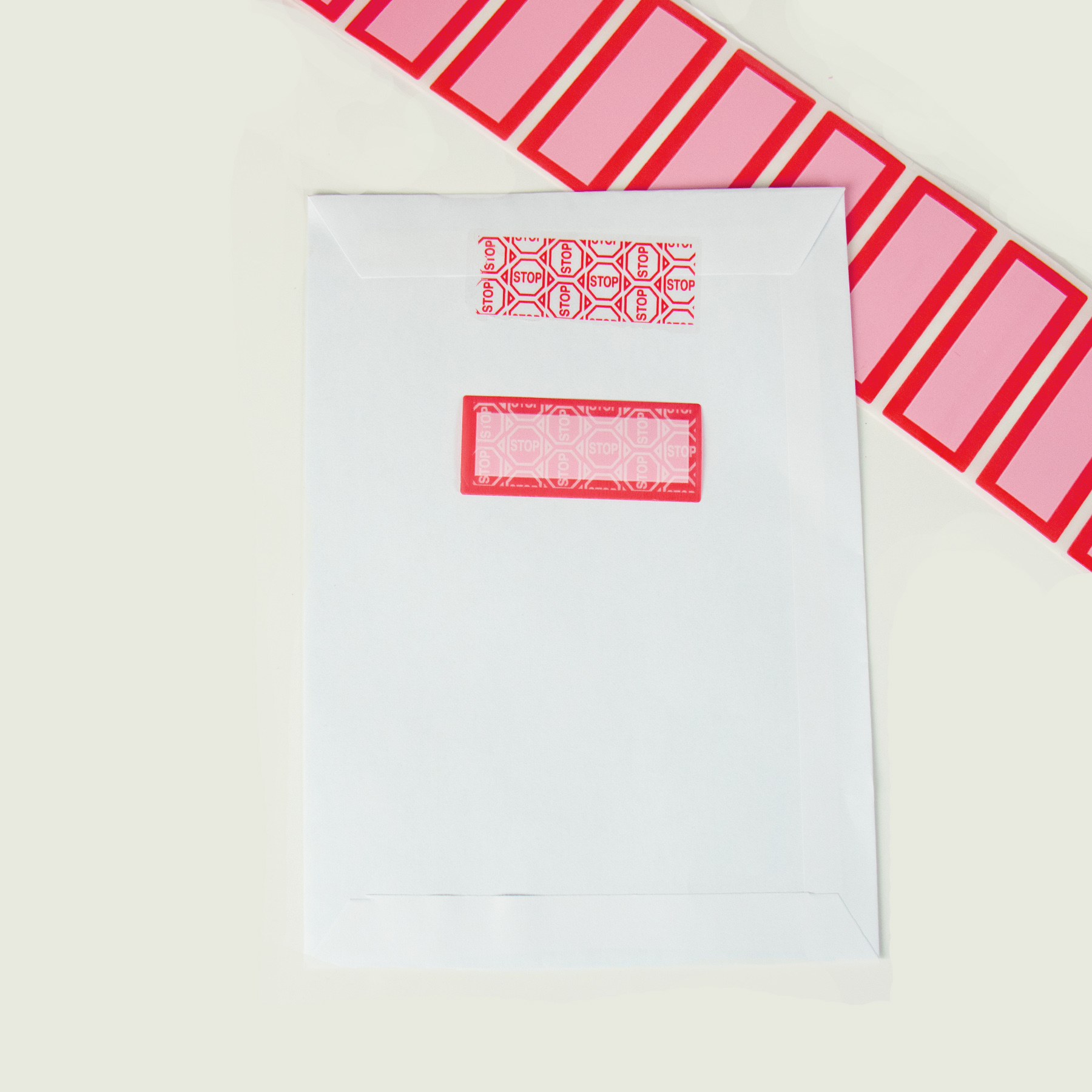 White Envelope with red tamper evident security label voided